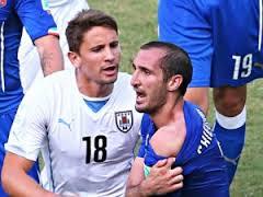 """Photo of Mondiali Brasile 2014: squalifica-record per """"Vampiro"""" Suarez. E per l'arbitro Moreno?"""