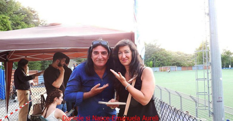 argos-2019-08-Emanuela-Aureli-e-Daniele-si-nasce-Renato-Zero.jpg
